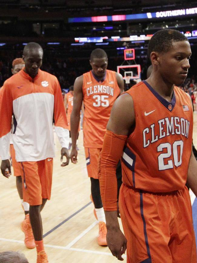 Clemson's Jordan Roper (20) and Landry Nnoko (35) leave the court during the second half of an NCAA college basketball game against SMU in the semifinals of the NIT Tuesday, April 1, 2014, in New York. SMU won the game 65-59