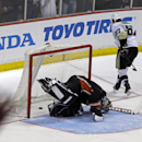 Anaheim Ducks goalie Jonas Hiller (1), of Switzerland, reacts after a goal by Pittsburgh Penguins center Sidney Crosby (87) in the third in s shootout in an NHL hockey game in Anaheim, Calif., Friday, March 7, 2014. The Penguins won the shootout, 3-2 The