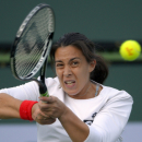 Marion Bartoli, of France, returns a shot to Chanelle Scheepers, of South Africa, at the BNP Paribas Open tennis tournament, Friday, March 8, 2013, in Indian Wells, Calif. (AP Photo/Mark J. Terrill)