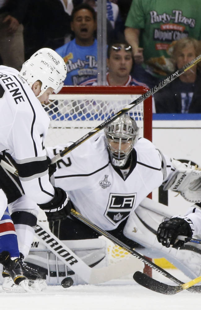 Los Angeles Kings goalie Jonathan Quick (32) looks for the rebound with defenseman Matt Greene (2) as New York Rangers left wing Chris Kreider (20) looks to score in the first period during Game 4 of the NHL hockey Stanley Cup Final, Wednesday, June 11, 2014, in New York