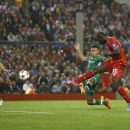 Liverpool's Mario Balotelli, second right, scores against Ludogorets during the Champions League Group B soccer match between Liverpool and Ludogorets at Anfield Stadium in Liverpool, England, Tuesday, Oct. 16, 2014
