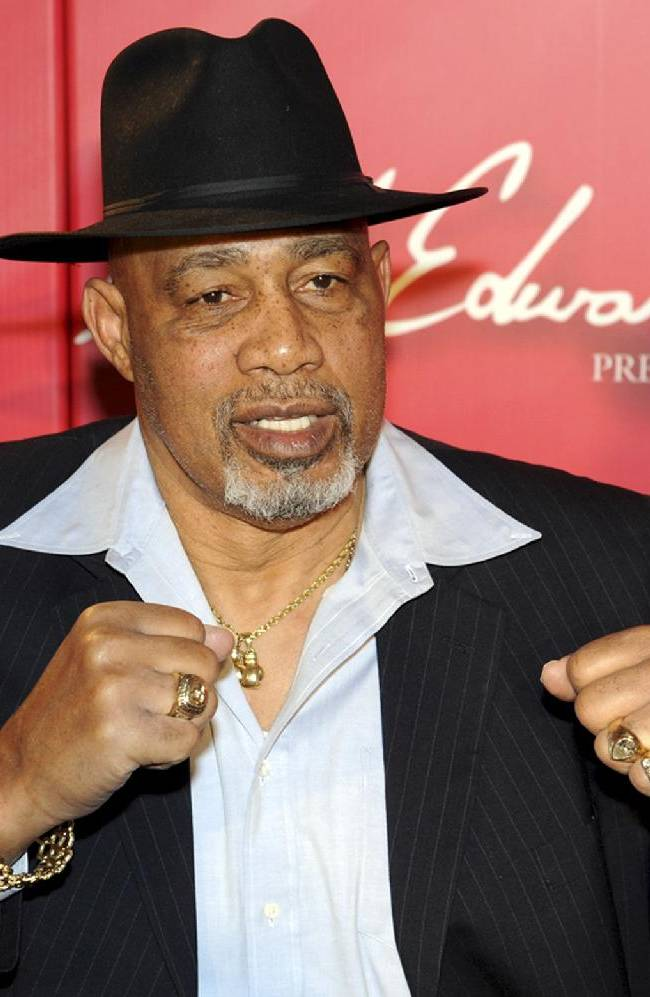 In this Feb. 18, 2012, file photo, provided by the Las Vegas News Bureau, former heavyweight boxer Ken Norton poses on the red carpet at the Keep Memory Alive