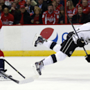 Washington Capitals right wing Joel Ward (42) steals the puck from Los Angeles Kings center Jeff Carter (77) who falls to the ice, in the second period of an NHL hockey game, Tuesday, March 25, 2014, in Washington The Associated Press