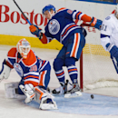 Tampa Bay Lightning forward Valtteri Filppula (51) reacts as he's hit by the puck, preventing it from crossing the line, behind Edmonton Oilers goalie Ben Scrivens (30) and defenceman Martin Marincin (85) during third period NHL hockey action in Edmonton,