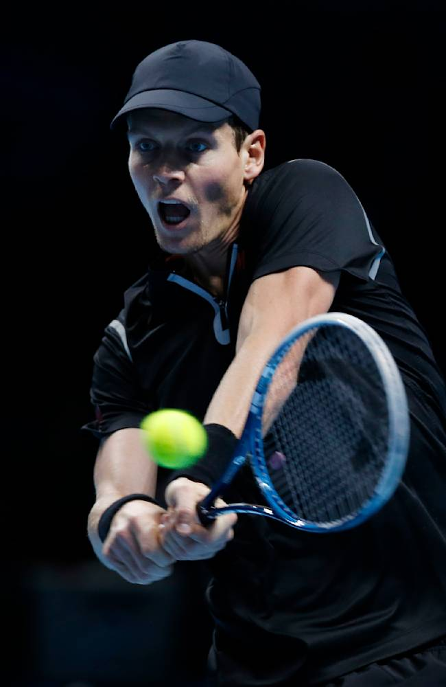 Tomas Berdych of Czech Republic plays a return to David Ferrer of Spain during their ATP World Tour Finals single tennis match at the O2 Arena in London Wednesday, Nov. 6, 2013