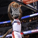 Washington Wizards center Emeka Okafor (50) dunks against Charlotte Bobcats forward Michael Kidd-Gilchrist, right, during the second half of an NBA basketball game, Saturday, March 9, 2013, in Washington. The Wizards won 104-87.(AP Photo/Nick Wass)
