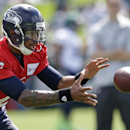 Seattle Seahawks quarterback Terrelle Pryor takes a snap at an NFL football camp practice Friday, July 25, 2014, in Renton, Wash. (AP Photo) The Associated Press