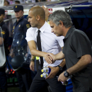FILE- In this Sunday Aug. 14, 2011 file picture, the then Real Madrid's coach Jose Mourinho from Portugal, right, shakes hands with former Barcelona's coach Josep Guardiola before their Super Cup first leg soccer match at the Santiago Bernabeu sta