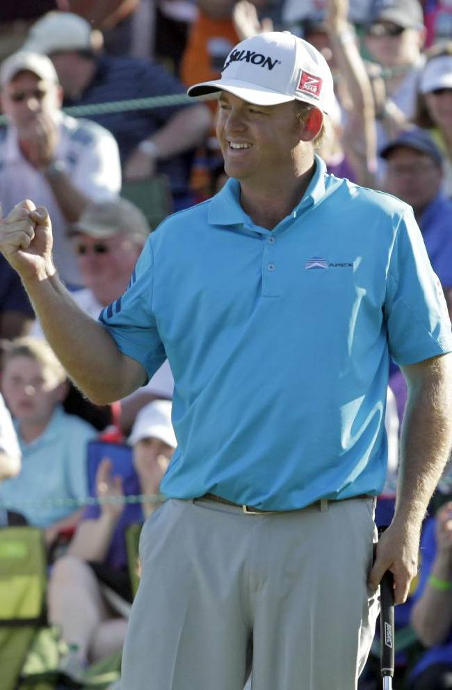J.B. Holmes reacts after winning the Wells Fargo Championship golf tournament in Charlotte, N.C., Sunday, May 4, 2014