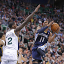 Memphis Grizzlies' Mike Conley (11) goes to the basket as Utah Jazz's Marvin Williams (2) defends in the second quarter during an NBA basketball game Wednesday, March 26, 2014, in Salt Lake City The Associated Press