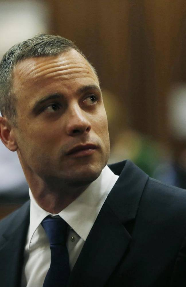 Oscar Pistorius is seated in a courtroom at the high court in Pretoria, South Africa, Tuesday, May 6, 2014. A man who lives next to the house where Pistorius fatally shot his girlfriend has testified at the athlete's murder trial about the night of the killing, saying he heard a man crying loudly and that he called the security of the housing estate for help. (AP Photo/Mike Hutchings, Pool)