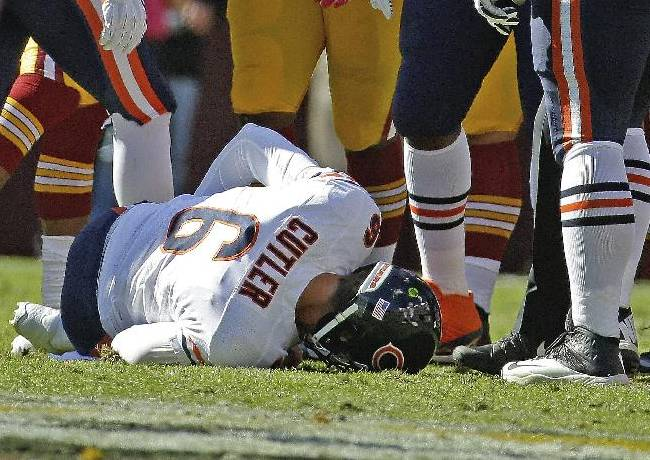 Chicago Bears quarterback Jay Cutler lies on the field after being injured in a sack by Washington Redskins defensive end Chris Baker during the first half of a NFL football game in Landover, Md., Sunday, Oct. 20, 2013