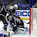 Colorado Avalanche's Nathan MacKinnon (29) scores past Tampa Bay Lightning goalie Ben Bishop (30) and defenseman Victor Hedman, of Sweden, during the third period of an NHL hockey game Saturday, Jan. 17, 2015, in Tampa, Fla. The Lightning won 3-2 The Asso