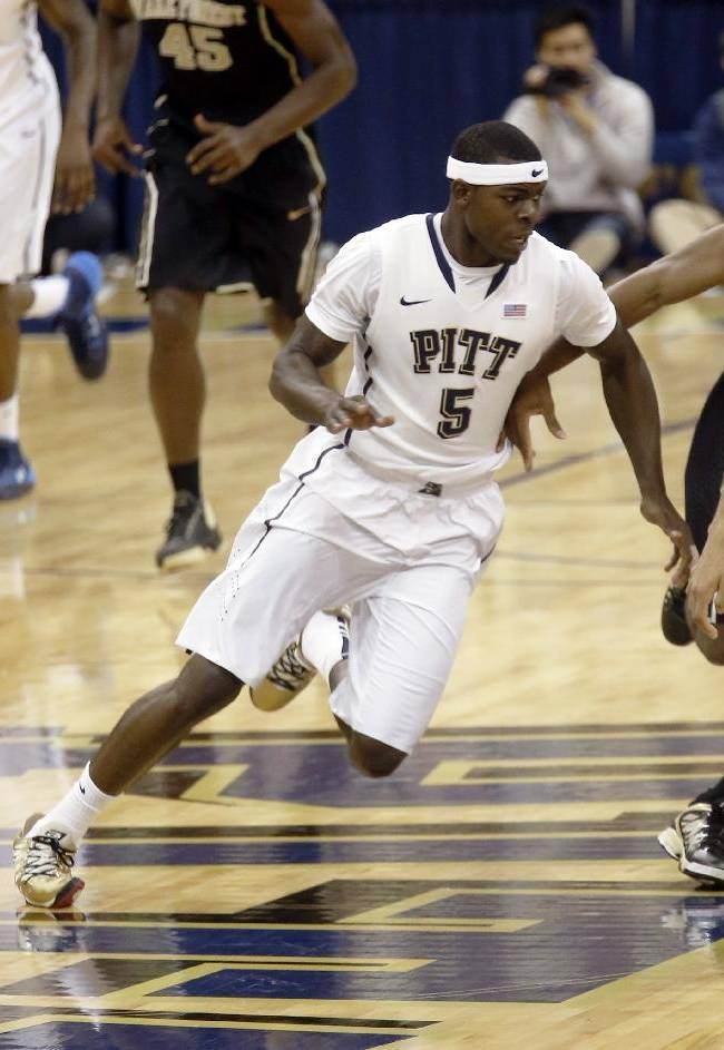 In this photo from Saturday, Jan. 11, 2014, Pittsburgh's Durand Johnson plays in the NCAA college basketball game between Pittsburgh and Wake Forest in Pittsburgh. Johnson will miss the rest of the season after tearing the ACL and meniscus in the game. He is expected to undergo surgery within the next week and to be back in 9 to 12 months