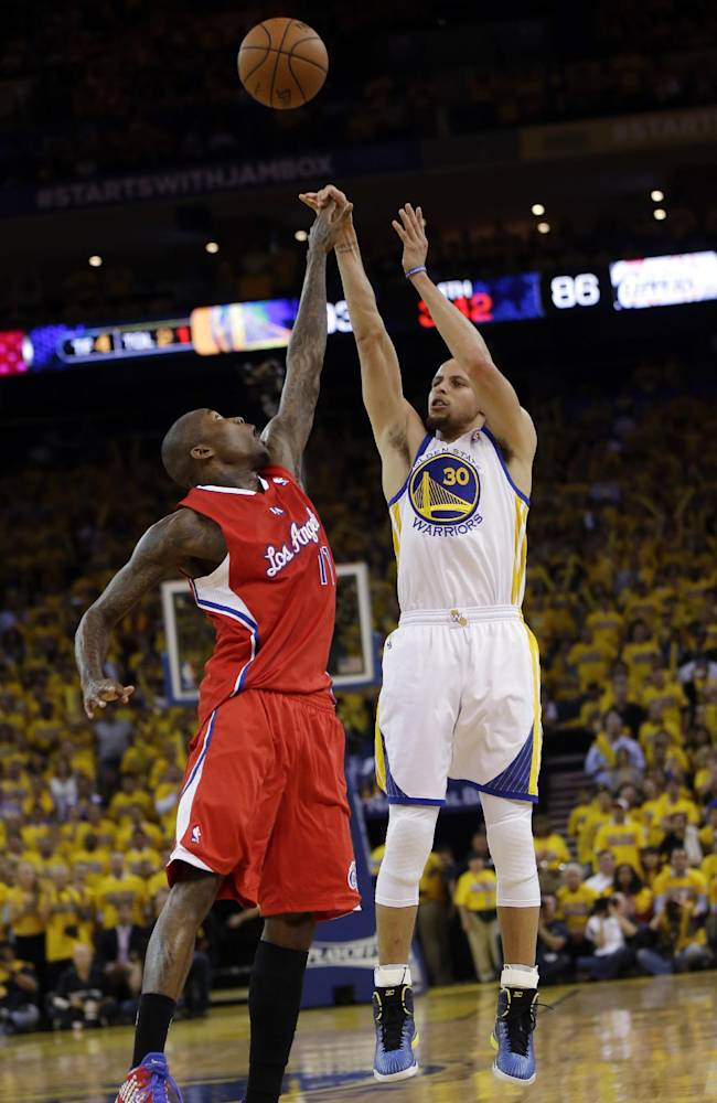 Golden State Warriors' Stephen Curry, right, shoots over Los Angeles Clippers' Jamal Crawford during the second half in Game 6 of an opening-round NBA basketball playoff series on Thursday, May 1, 2014, in Oakland, Calif. Golden State won 100-99