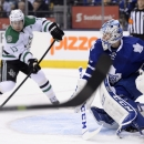 Toronto Maple Leafs goalie Jonathan Bernier watches for the puck as Dallas Stars' Ray Whitney (13) looks to shoot during the first period of an NHL hockey game, Thursday, Dec. 5, 2013 in Toronto The Associated Press