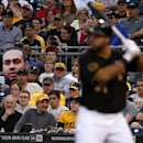 A fan of Pittsburgh Pirates' Pedro Alvarez (24) holds a giant photo of him as Alvarez bats during the fourth inning of a baseball game against he Cincinnati Reds in Pittsburgh Monday, April 21, 2014. Alvarez singled off Cincinnati Reds starting pitcher M