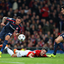 Manchester United's Robin van Persie, center, goes down for a penalty off a challenge from Olympiakos' Jose Holebas, left, during their Champions League last 16 second leg soccer match at Old Trafford Stadium, Manchester, England, Wednesday, March 19, 201