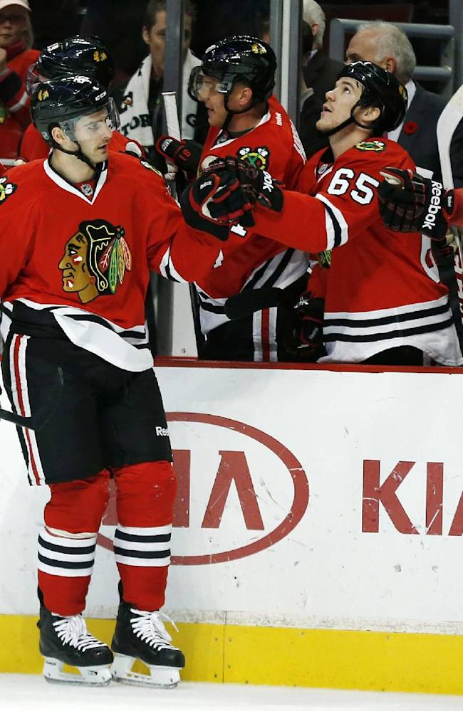 Chicago Blackhawks left wing Brandon Saad (20) celebrates after scoring a goal against the Edmonton Oilers during the first period of an NHL hockey game on Sunday, Nov. 10, 2013, in Chicago