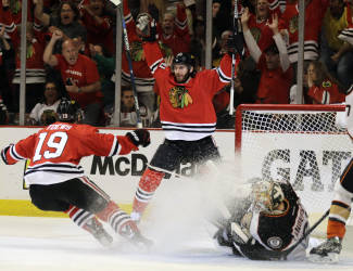 FILE - In this Wednesday, May 27, 2015, file photo, Chicago Blackhawks left wing Brandon Saad celebrates his goal against Anaheim Ducks goalie Frederik Andersen with Jonathan Toews (19) during the second period in Game 6 of the Western Conference finals of the NHL hockey Stanley Cup Playoffs in Chicago. The Blackhawks have traded Saad to the Columbus Blue Jackets in a seven-player deal. (AP Photo/Nam Y. Huh, File)