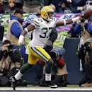 Green Bay Packers' Sam Shields (37) reacts after intercepting a pass during the first half of the NFL football NFC Championship game against the Seattle Seahawks Sunday, Jan. 18, 2015, in Seattle The Associated Press