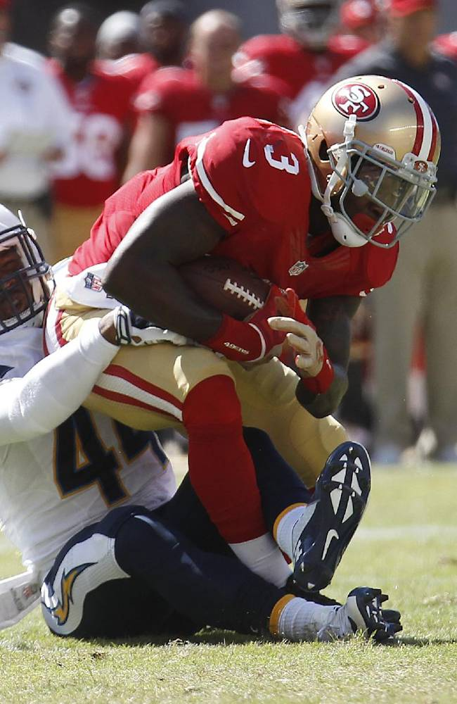 San Francisco 49ers wide receiver Bruce Ellington (3) is tackled by San Diego Chargers defensive back Adrian Phillips (44) during the fourth quarter of an NFL preseason football game in Santa Clara, Calif., Sunday, Aug. 24, 2014. The 49ers won 21-7