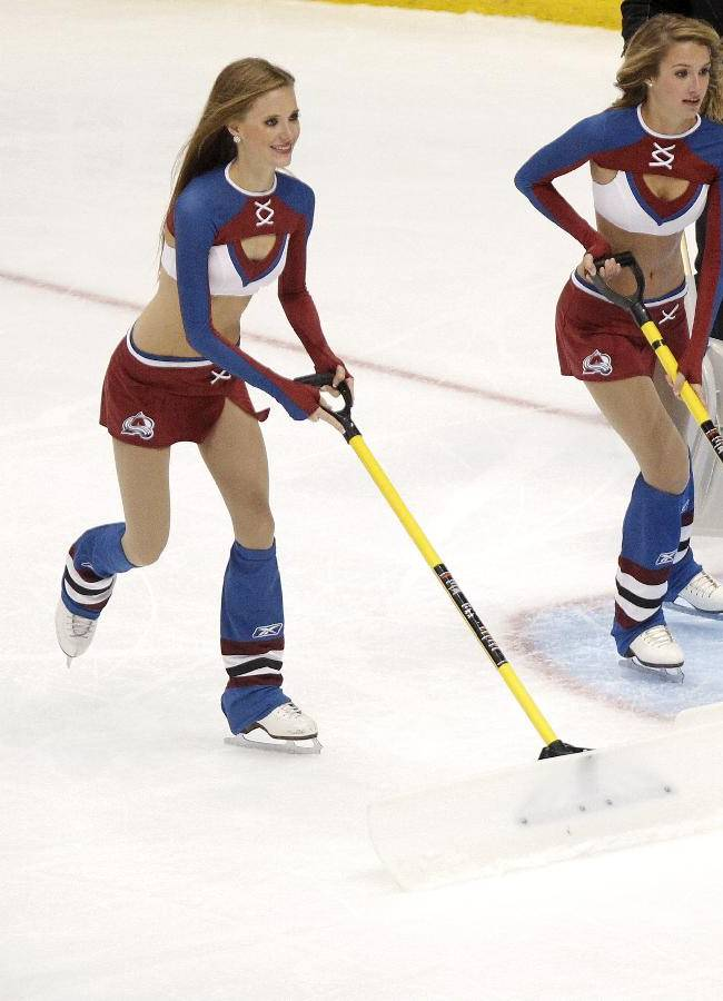 Colorado Avalanche goalie Sami Aittokallio (30), of Finland, waits for the new Avalanche Ice Girls to clear the ice during the third period of an NHL hockey game against the Dallas Stars on Tuesday, Sept. 24, 2013 in Denver. The Stars won 5-3