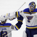 St. Louis Blues' Kevin Shattenkirk (22) and goalie Jake Allen react following Shattenkirk's goal in the shootout against the Carolina Hurricanes in an NHL hockey game in Raleigh, N.C., Friday, Jan. 30, 2015. St. Louis won 3-2. (AP Photo/Gerry Broome)