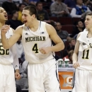 Michigan's Jordan Morgan (52), Mitch McGary (4) and Nik Stauskas (11) react during the second half of an NCAA college basketball game at the Big Ten tournament against Penn State Thursday, March 14, 2013, in Chicago. (AP Photo/Nam Y. Huh)