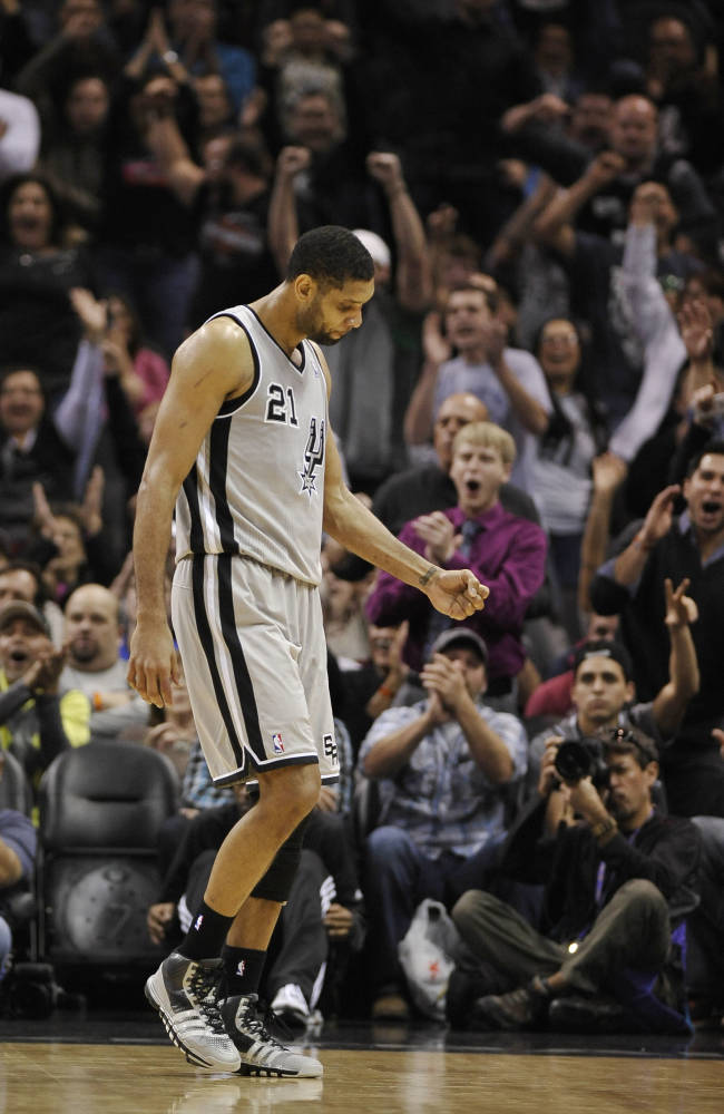 San Antonio Spurs forward Tim Duncan celebrates a basket in the closing minutes of an NBA basketball game against the Sacramento Kings on Sunday, Dec. 29, 2013, in San Antonio. San Antonio won 112-104