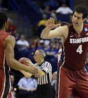 Stanford's Stefan Nastic (4) celebrates with teammate Chasson Randle near the end of the second half of a second-round game against New Mexico in the NCAA college basketball tournament Friday, March 21, 2014, in St. Louis. Stanford won 58-53. AP Photo/Jeff Roberson)