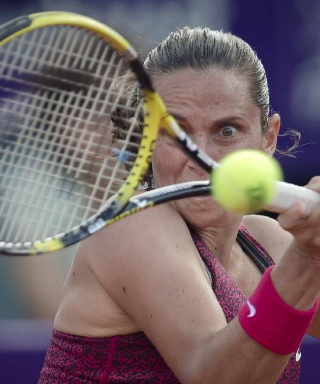 Italy's Roberta Vinci returns to Romania's Simona Halep in the singles final match of a WTA Bucharest Open women's tennis tournament in Bucharest, Romania, Sunday, July 13, 2014. Halep defeated Vinci in two sets to win the tournament