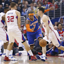 New York Knicks' Carmelo Anthony, second right, is screened by Los Angeles Clippers' Blake Griffin, second left, while J.J. Redick, right, dribbles the ball and DeAndre Jordan, rear left, also defends during the first half of an NBA basketball game in Los