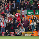 Liverpool's Raheem Sterling celebrates after scoring against Southampton during their English Premier League soccer match at Anfield Stadium, Liverpool, England, Sunday Aug. 17, 2014