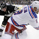 New York Rangers' Kevin Klein (8) beats Pittsburgh Penguins' Sidney Crosby (87) to a puck in the corner during the second period of an NHL hockey game, Sunday, Jan. 18, 2015, in Pittsburgh The Associated Press