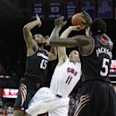 SMU guard Nic Moore (11) shoots against Cincinnati forwards Jermaine Sanders (15) and Justin Jackson (5) during the second half of an NCAA college basketball game Saturday, Feb. 8, 2014, in Dallas. SMU won 76-55. (AP Photo/LM Otero)