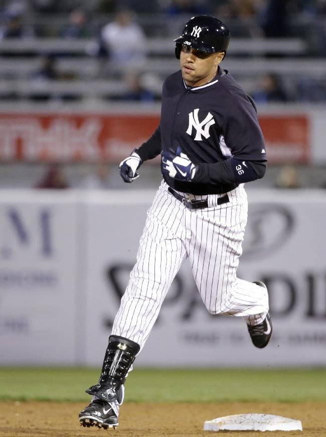 New York Yankees' Carlos Beltran runs the bases after hitting a third-inning two-run home run off Detroit Tigers starting pitcher Anibal Sanchez in a spring training baseball game in Tampa, Fla., Friday, March 7, 2014.  The Yankees defeated the Tigers 3-2