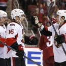 Ottawa Senators' Clarke MacArthur (16) celebrates his goal against the Arizona Coyotes with teammates Kyle Turris (7) and Erik Karlsson (65), of Sweden, during the first period of an NHL hockey game Saturday, Jan. 10, 2015, in Glendale, Ariz The Associate