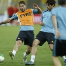 Spain's Sergio Ramos, left, and Javier Martinez, right, vie for the ball during a training session at Maracana stadium in Rio de Janeiro, Brazil, Saturday, June 29, 2013. Spain will face Brazil on Sunday for the final match. (AP Photo/Victor R. Caivano)