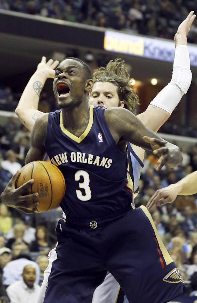 New Orleans Pelicans' Anthony Morrow (3) is pressured by Memphis Grizzlies' Mike Miller in the first half of an NBA basketball game in Memphis, Tenn., Wednesday, Nov. 6, 2013