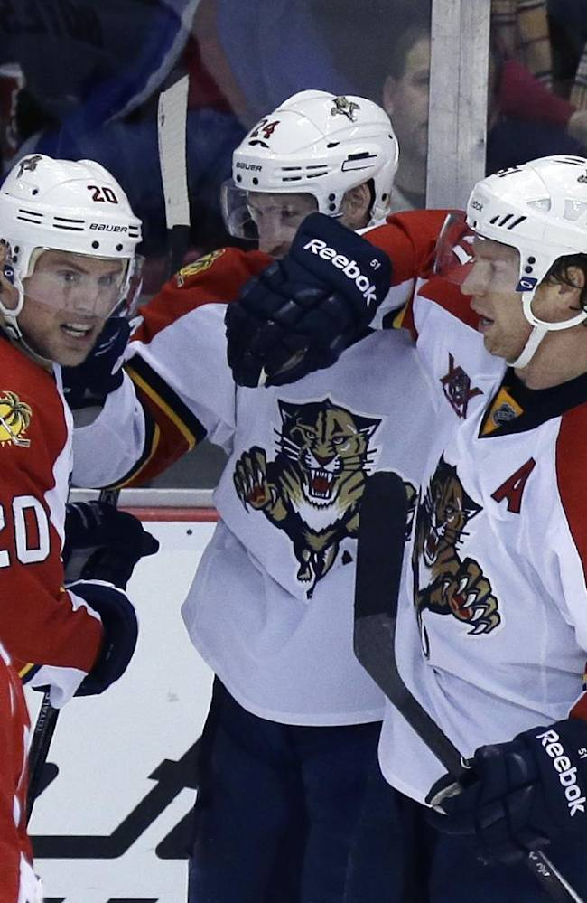 Florida Panthers left wing Sean Bergenheim (20) of Finland, right wing Brad Boyes (24), and defenseman Brian Campbell (51) celebrate Boyes' game tying goal as Detroit Red Wings center Gustav Nyquist (14) of Sweden skates by during the third period of an NHL hockey game in Detroit, Sunday, Jan. 26, 2014