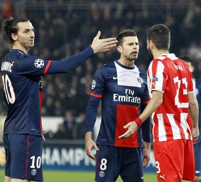 Olympiakos' Dimitris Siovas, right, argues with PSG's Thiago Motta while Zlatan Ibrahimovic, left, looks on during the Group C Champions League soccer match between Paris Saint Germain and Olympiakos FC at the Parc des Princes stadium in Paris, France, Wednesday, Nov. 27, 2013