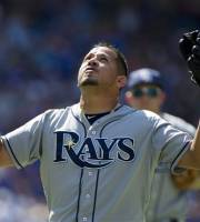 Tampa Bay Rays pitcher Joel Peralta celebrates as he walks off the field following the eight inning of a baseball game against the Toronto Blue Jays in Toronto on Saturday, July 20, 2013. (AP Photo/The Canadian Press, Frank Gunn)