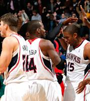 ATLANTA, GA - DECEMBER 13: Al Horford #15 of the Atlanta Hawks reacts after hitting the game-winning basket in a 101-99 overtime win over the Washington Wizards at Philips Arena on December 13, 2013 in Atlanta, Georgia. (Photo by Kevin C. Cox/Getty Images)