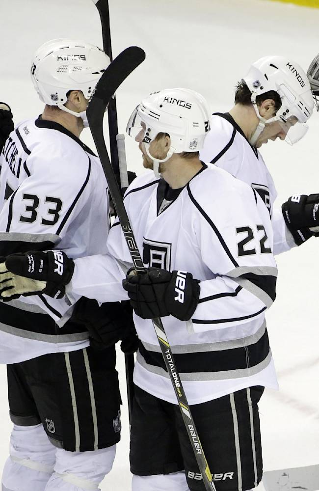 The Los Angeles Kings celebrate after a 1-0 win over the San Jose Sharks during an NHL hockey game on Monday, Jan. 27, 2014, in San Jose, Calif