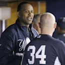 New York Yankees starting pitcher CC Sabathia talks with Yankees catcher Brian McCann (34) in the dugout after pitching seven innings in the Yankees 4-0 shutout of the Pittsburgh Pirates in a spring exhibition baseball game in Tampa, Fla., Friday, March 2
