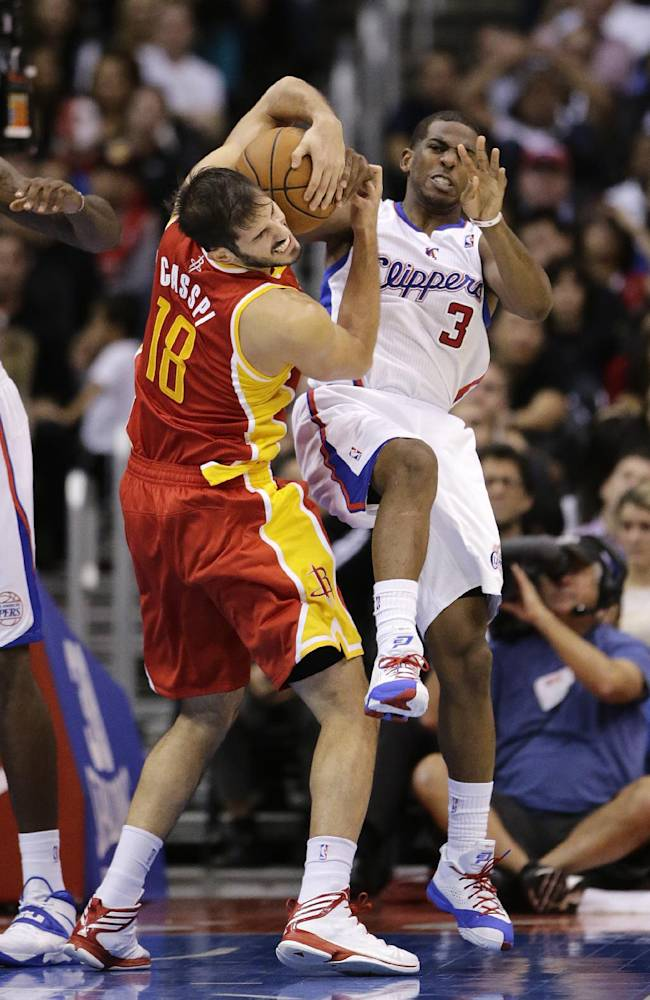 Houston Rockets' Omri Casspi, left, of Israel, and Los Angeles Clippers' Chris Paul fight for a rebound during the second half of an NBA basketball game on Monday, Nov. 4, 2013, in Los Angeles. The Clippers won 137-118