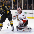 Ottawa Senators goalie Robin Lehner makes a save as Boston Bruins' Loui Eriksson looks for the rebound during the third period of the Senators 3-2 shootout win in a shootout in an NHL hockey game in Boston Saturday, Dec. 13, 2014 The Associated Press