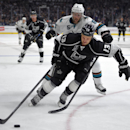 Los Angeles Kings left wing Kyle Clifford, right, and San Jose Sharks defenseman Jason Demers battle for the puck during the second period of an NHL hockey game, Wednesday, Oct. 8, 2014, in Los Angeles The Associated Press
