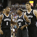Brooklyn Nets guard Jason Terry, center, is restrained by teammates Alan Anderson, left, and Brooks Lopez, after exchanging heated words with Sacramento Kings guard Greivis Vasquez during the fourth quarter of an NBA basketball game in Sacramento, Calif.,